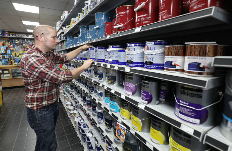 Richard Burr looks at paint (Philip Toscano/PA).