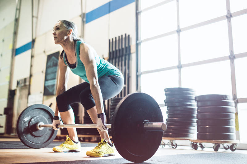 Keep fit over 50 by building muscle and strength training.