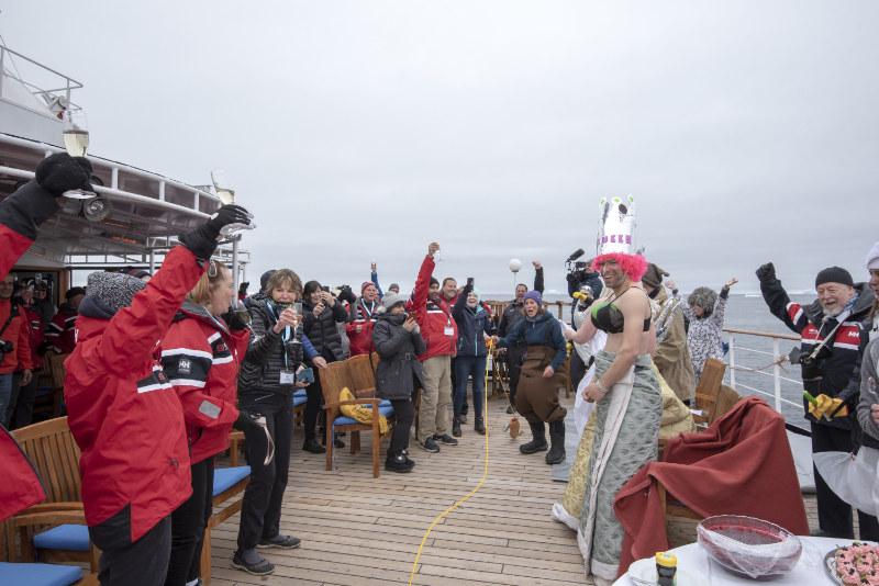 A slapstick ceremony to celebrate crossing the Antarctic Circle (Renato Granieri/PA)