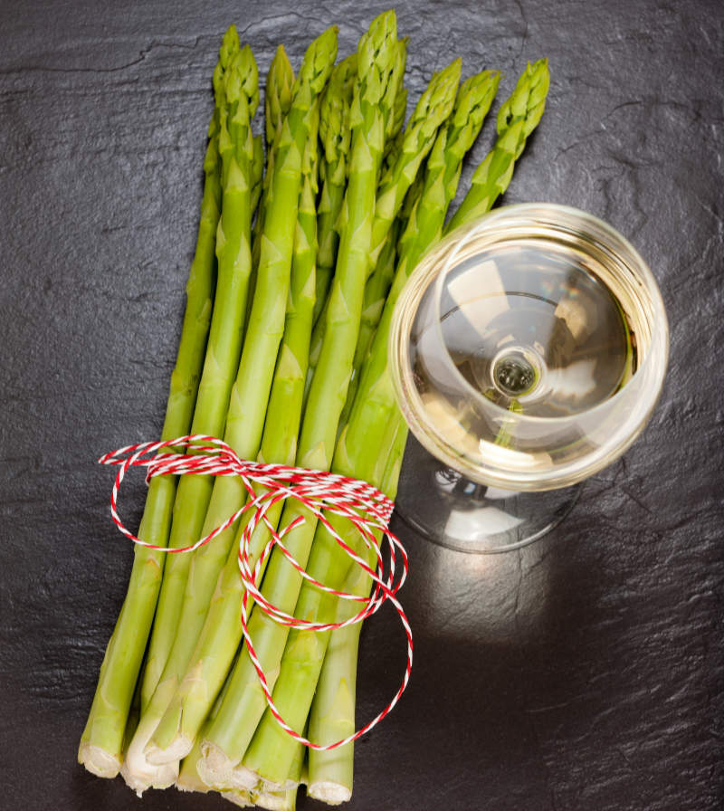 aphrodisiac foods Green Asparagus with White Wine on a Slate plate as a Top Shot