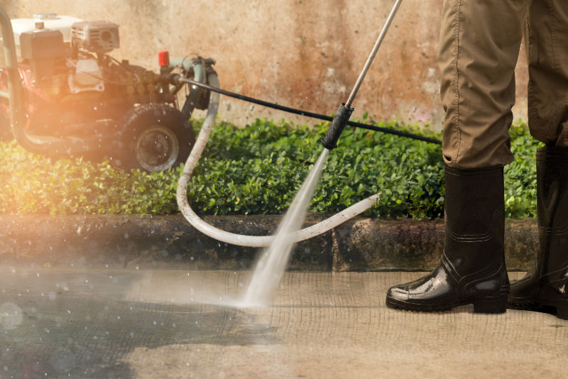Use a power washer to clean outside your home