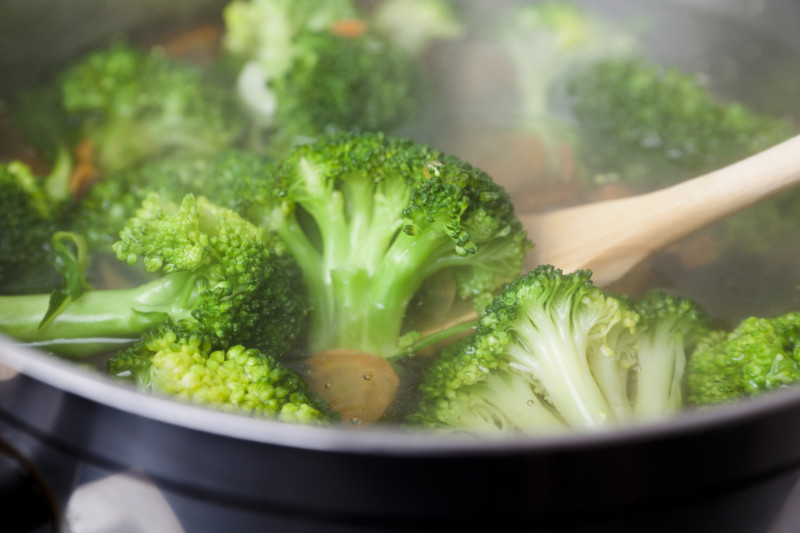 Vegan bloating Boiling broccoli and carrots in casserole (steam visible)see also: