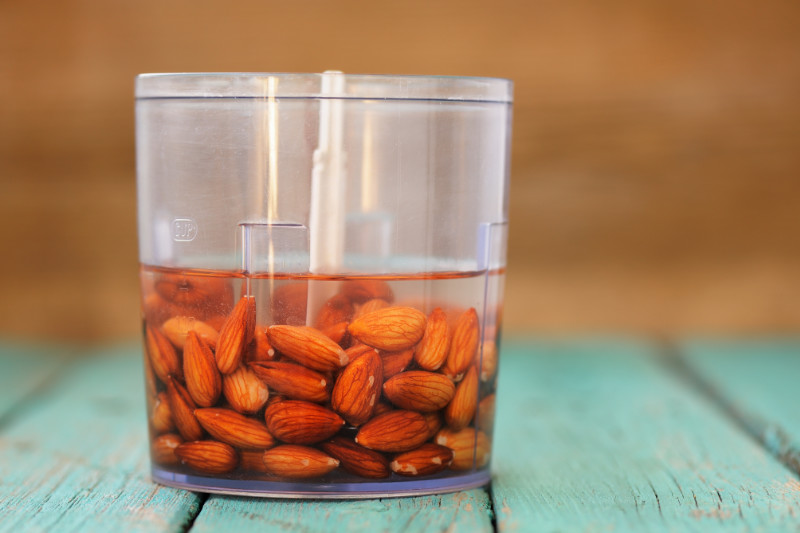 Vegan bloating Soaked almonds ready for making almond milk in blender