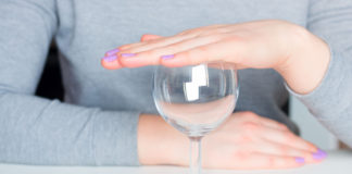 Young woman with empty wine glass, saying no to alcohol (iStock/PA)