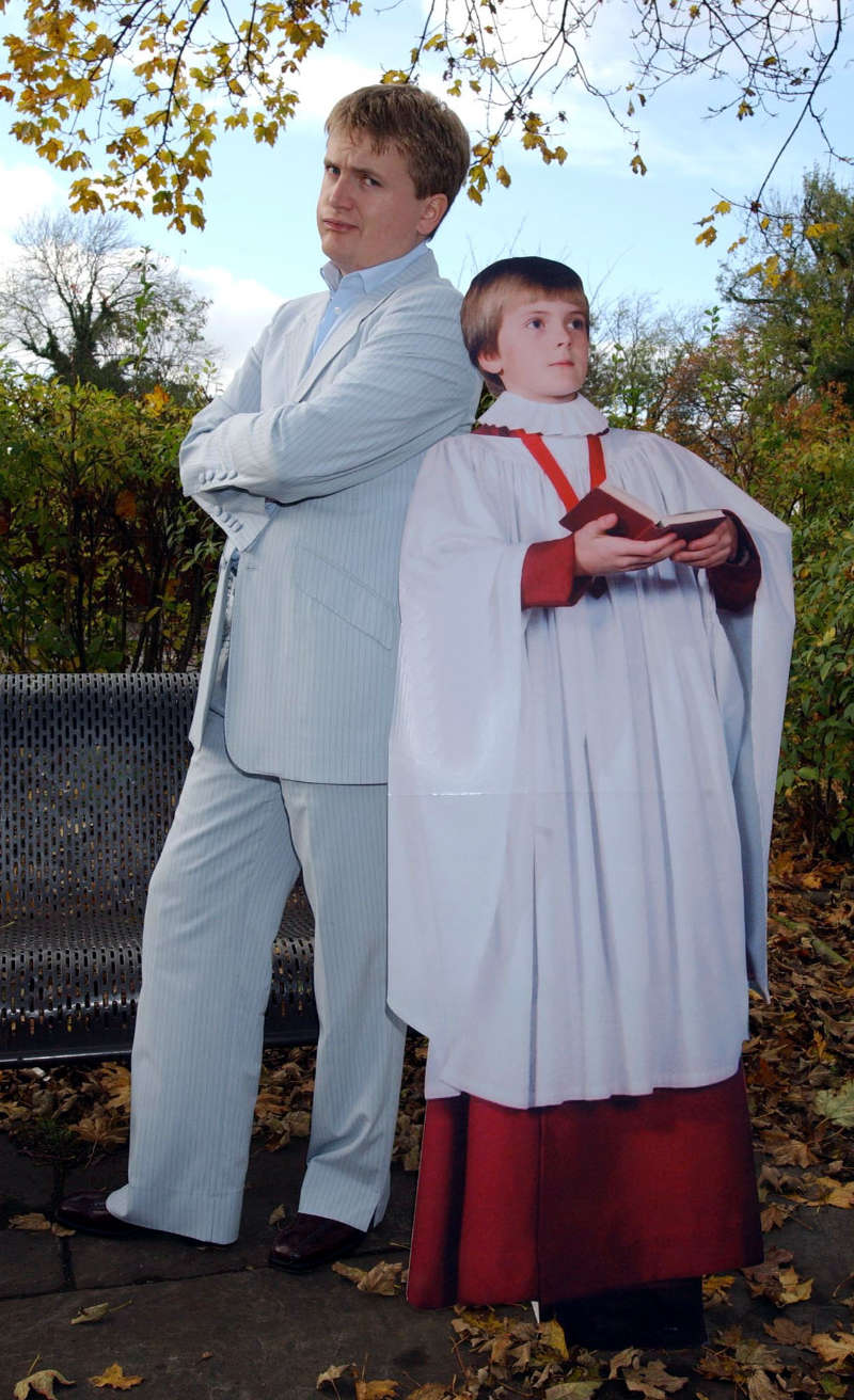 A young Aled Jones poses with a cardboard cut-out of an even younger Aled Jones