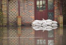 Flood insurance sandbags outside house front door