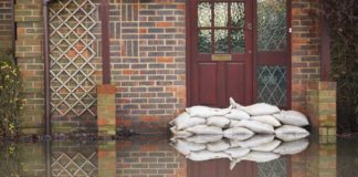 Flood insurance sandbags outside house front door