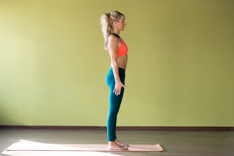 Good posture woman standing straight in exercise clothes