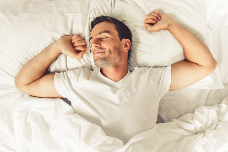 How to stop oversleeping - man in bed in morning