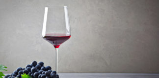 Shiraz wine with red grapes (iStock/PA)