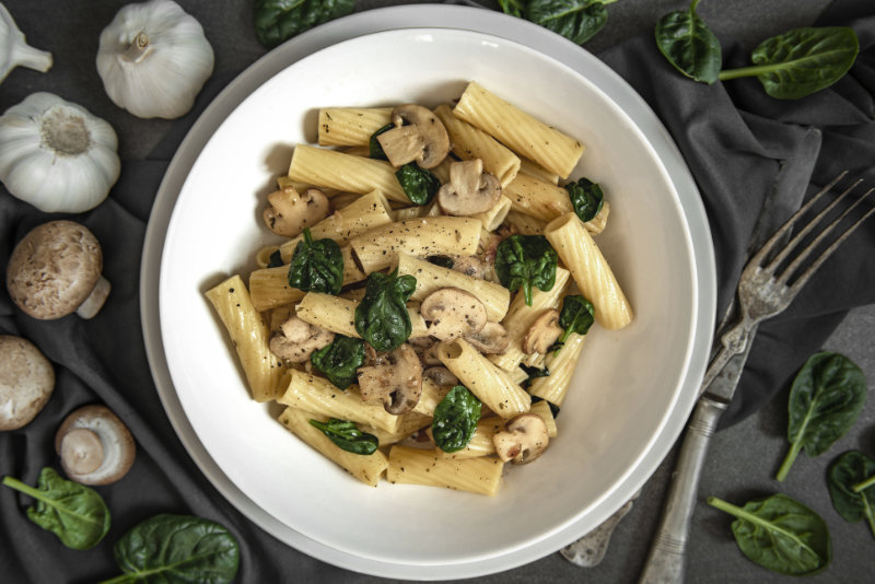 Healthy vegan spinach and mushrooms pasta to help improve brain health.