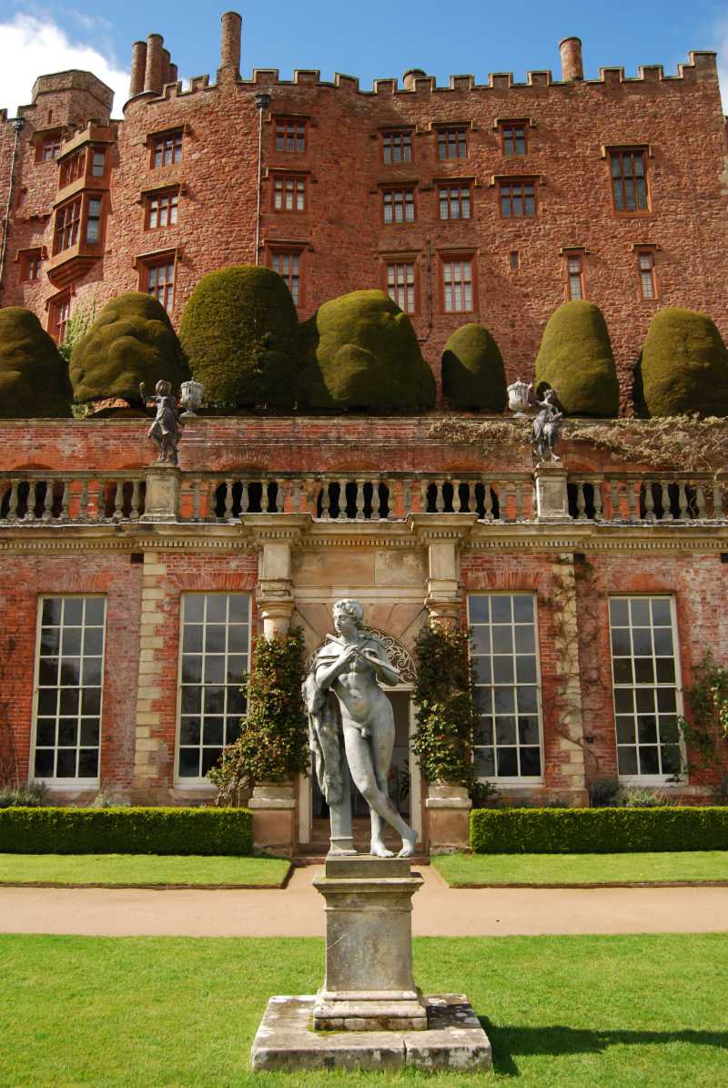 Powis Castle (Welsh: Castell Powis or Castell Coch) is a medieval castle, fortress and grand country mansion located near the town of Welshpool, in Powys, Mid Wales.