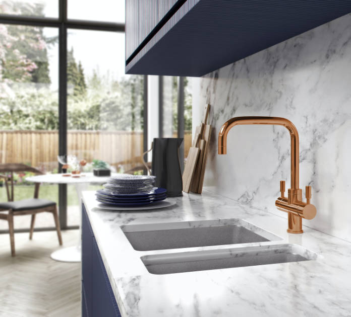 Franke's Omni Contemporary 4-in-1 tap, shown here in Copper, RRP £1,600, can dispense 100⁰C filtered boiling water, filtered cold water and standard mains hot and cold, all from a single lever-operated tap (Franke/PA)