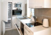 How to make a small kitchen look bigger Small whitewashed kitchen
