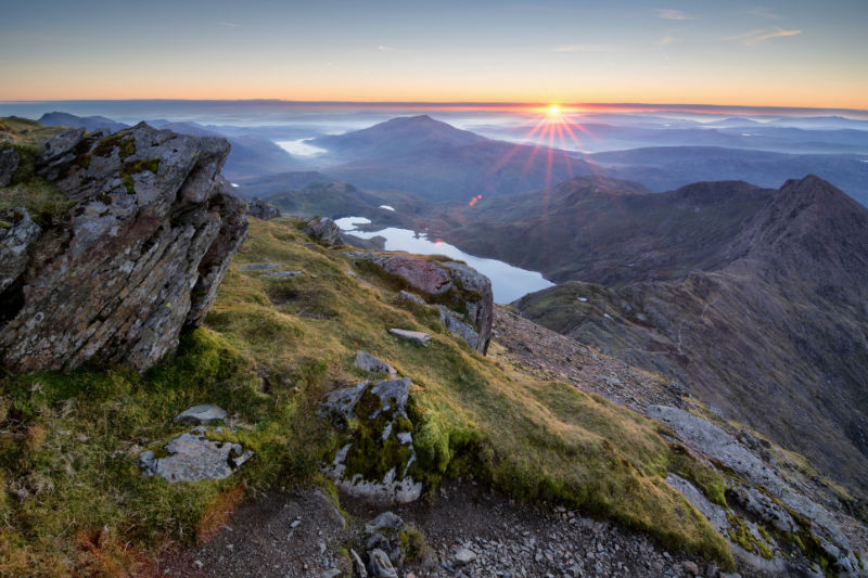 An amazing sunrise over the Snowdonia national park as view from the summit of Snowdon on a cold Octobers morning.