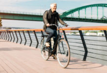 Best cycling kit and bikes for beginners - woman commuting on a bike