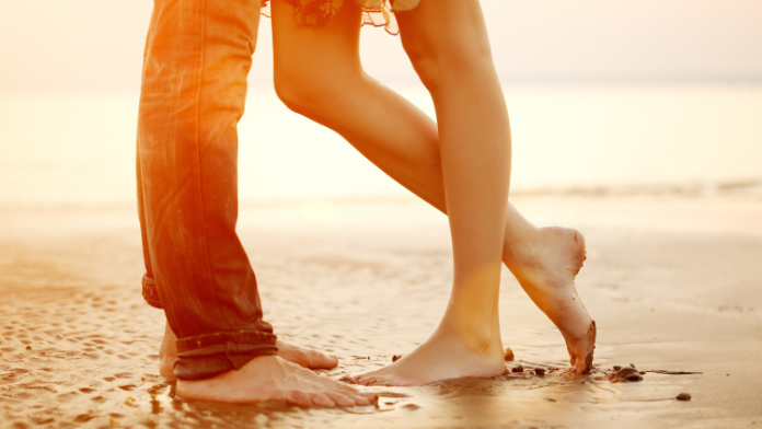 Generic photo showing the feet of a young couple standing on a beach (Thinkstock/PA)