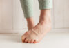 Generic photo of a woman with bare feet curling her toes in order to hide them (Thinkstock/PA)