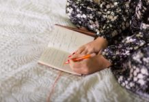 Generic photo of a woman writing in a notepad (ThinkStock/PA)