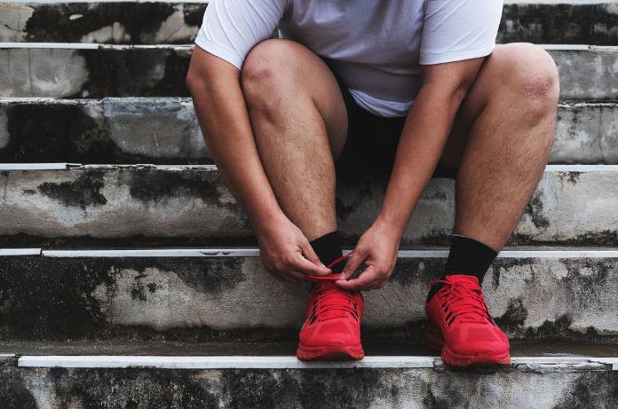 Man Tying Running Shoe, Preparing to Running for Losing Weight