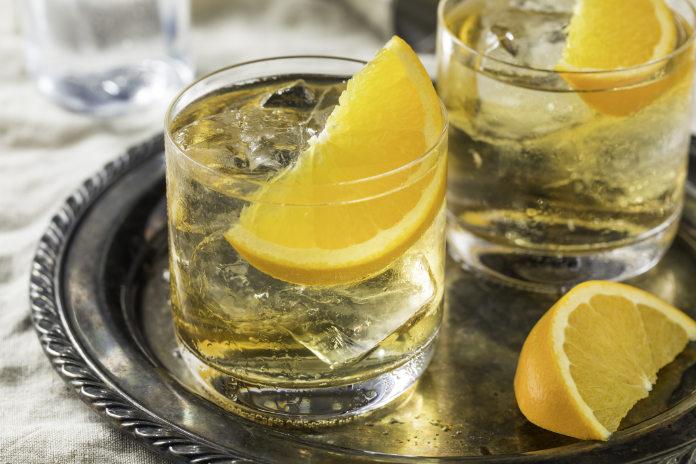 Refreshing White Port and Tonic with Orange Garnish
