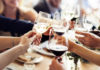 People clinking their wine glasses together (ThinkStock/PA)