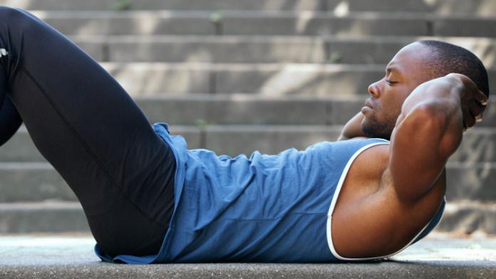 Generic photo of a man doing sit-ups (ThinkStock/PA)