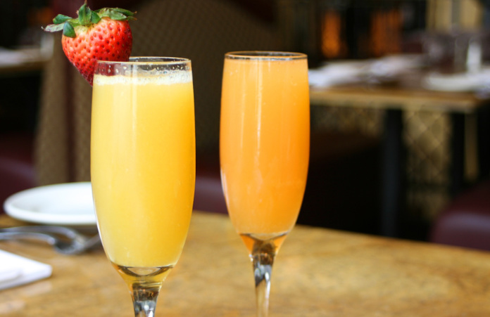 Two mimosa cocktail glasses