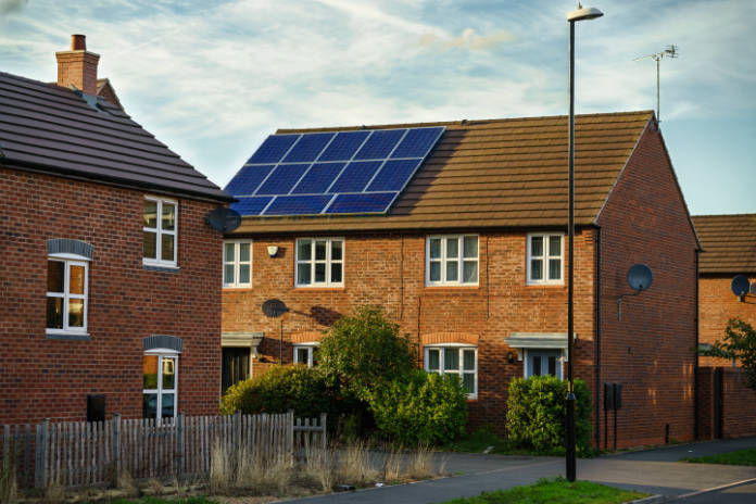 Solar photovoltaic panels mounted on a tiled new familiy houses roof