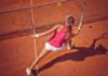 Health benefits of tennis Female tennis player hitting a ball with forehand volley
