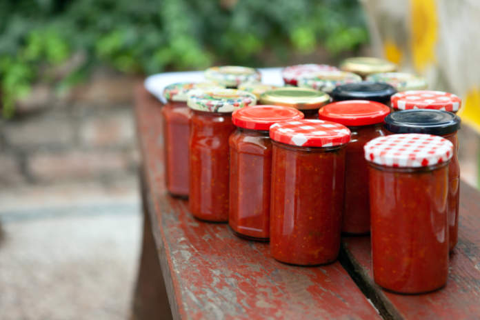 Pickled Homemade Tomato Sauce on a Table in Jars