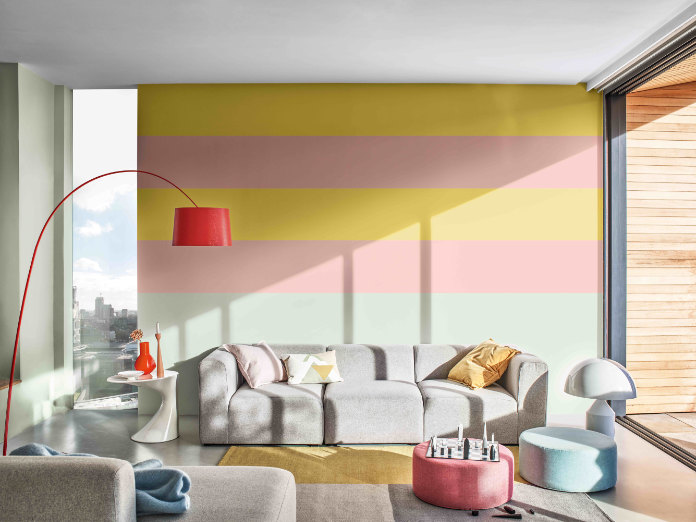 Living room painted in Dulux Copper Blush, Tranquil Dawn and Citrus Zing (Dulux/PA)