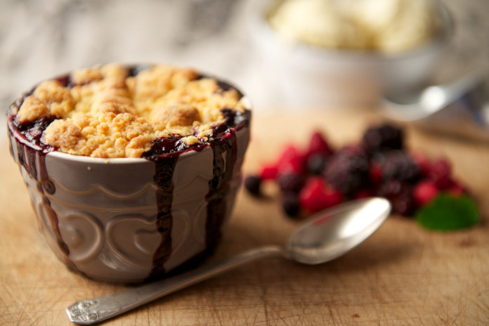 Mixed Berry Crumble Dessert with Ice Cream in the Background