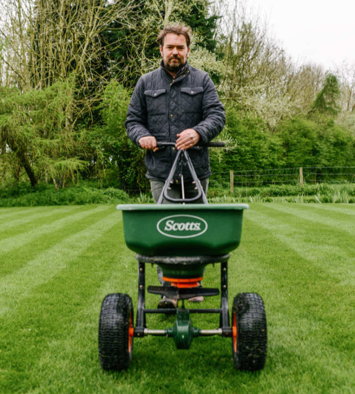 David Hedges-Gower feeds his lawn (David Hedges-Gower/PA)