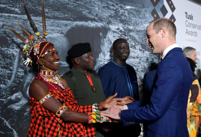 Award finalist Jeneria Lekilelei is congratulated by the Duke of Cambridge during the 2019 Tusk Conservation Awards (Toby Melville/PA)
