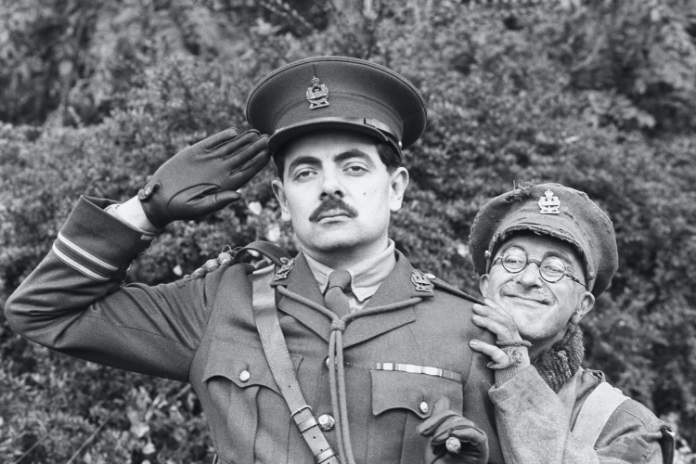 Rowan Atkinson as Captain Edmund Blackadder (left) with Tony Robinson as Private Baldrick. They are promoting the new series of Blackadder, which is set during the First World War. (Martin Keene/PA)