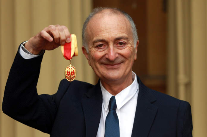 Holding up his knighthood at the palace (Sean Dempsey/PA)