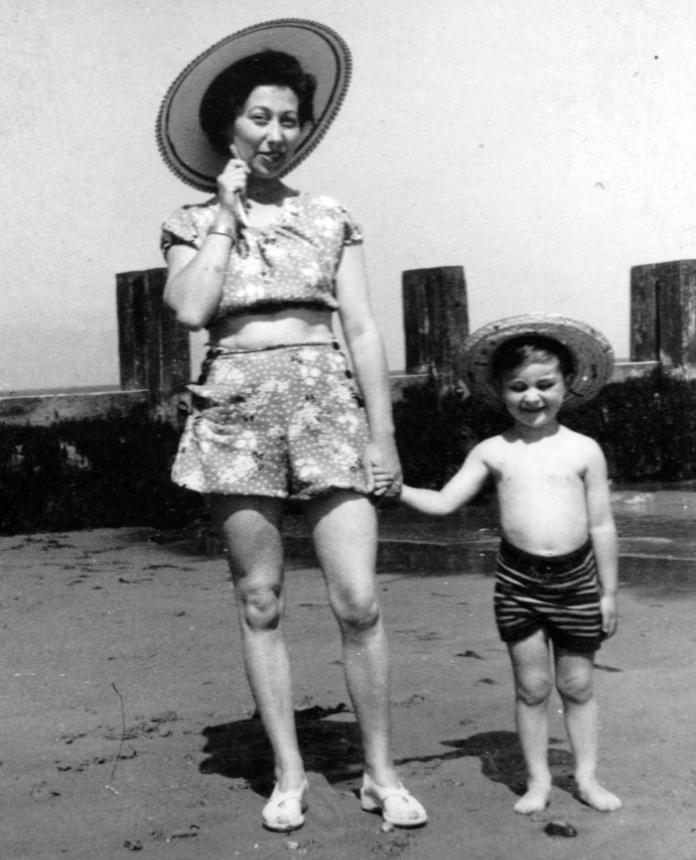 With his mother on a childhood trip to the beach (Tony Robinson/PA)
