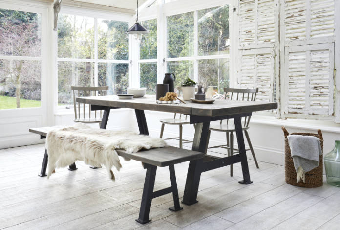A-Game Industrial-Style Reclaimed Dining Table, from £1790–£2110; A-Game A-Frame Reclaimed Bench, from £390–£450, Rust Collections (Rust Collections/PA)