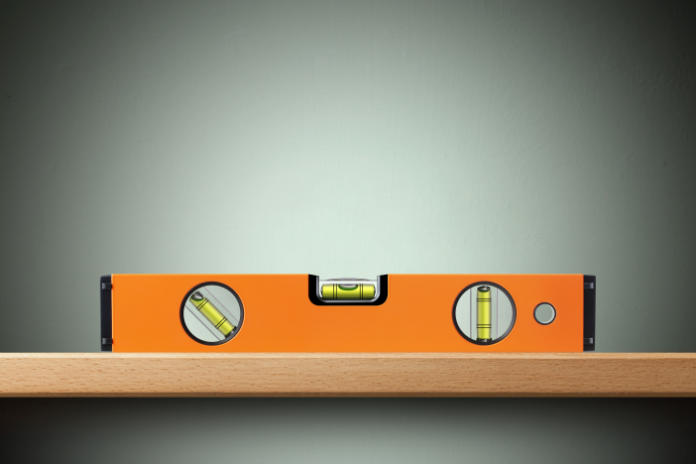 Make sure the shelf is straight by using a spirit level.