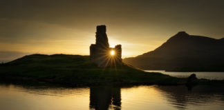 UK Beauty spots: Ardvreck Castle reflections on Loch Assynt in sunset light, Scotland