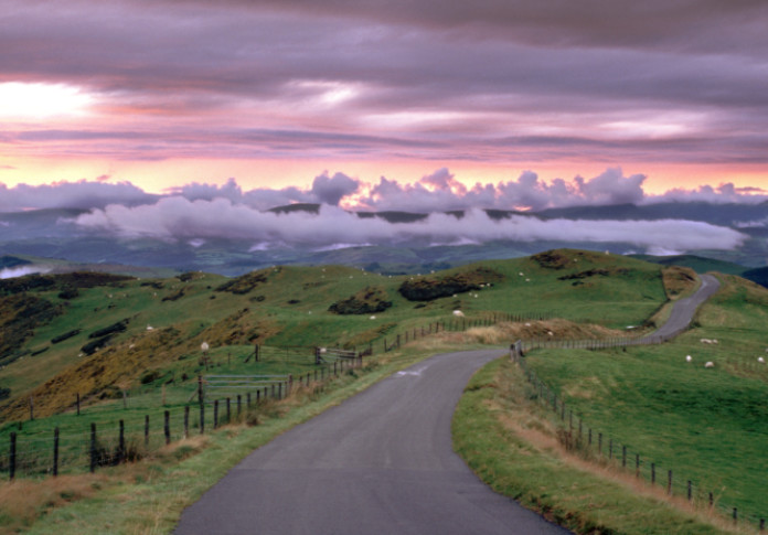 Wales, Powys, near Machynlleth, storm cloud sunset, winding road
