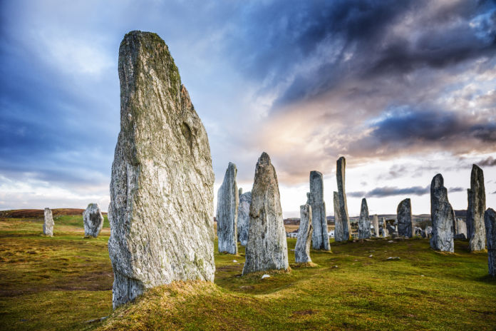 The ancient standing stones of Callanish (or Calanais) on Lewis in the Outer Hebrides of Scotland. Built about 5000 years ago, the deeply textured stones of Callanish are arranged in allignments of avenues and a central circle not unlike a celtic cross.