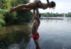 Couple recreating the Dirty Dancing lift in a lake