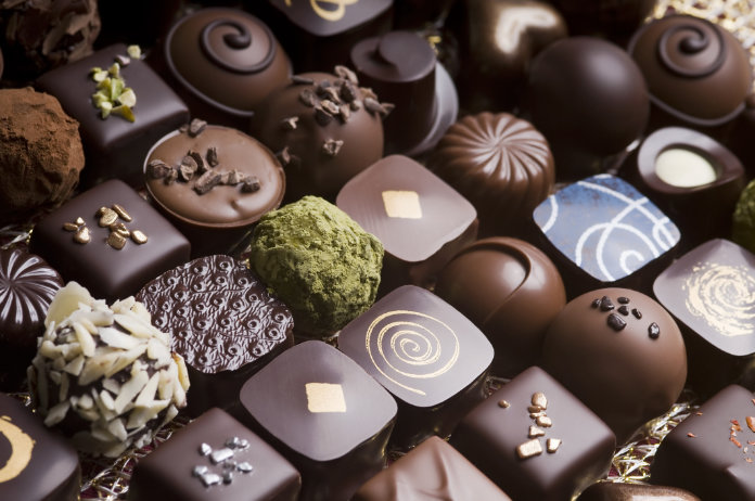 Assorted delicious handmade chocolate pralines in a row