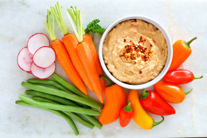 Hummus dip with a variety of fresh vegetables