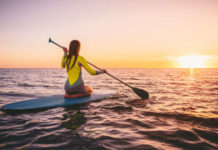 Paddleboarding is set to be this summer's standout activity (iStock/PA)