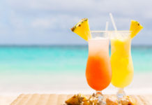 Two tropical cocktails on white sandy beach (iStock/PA)