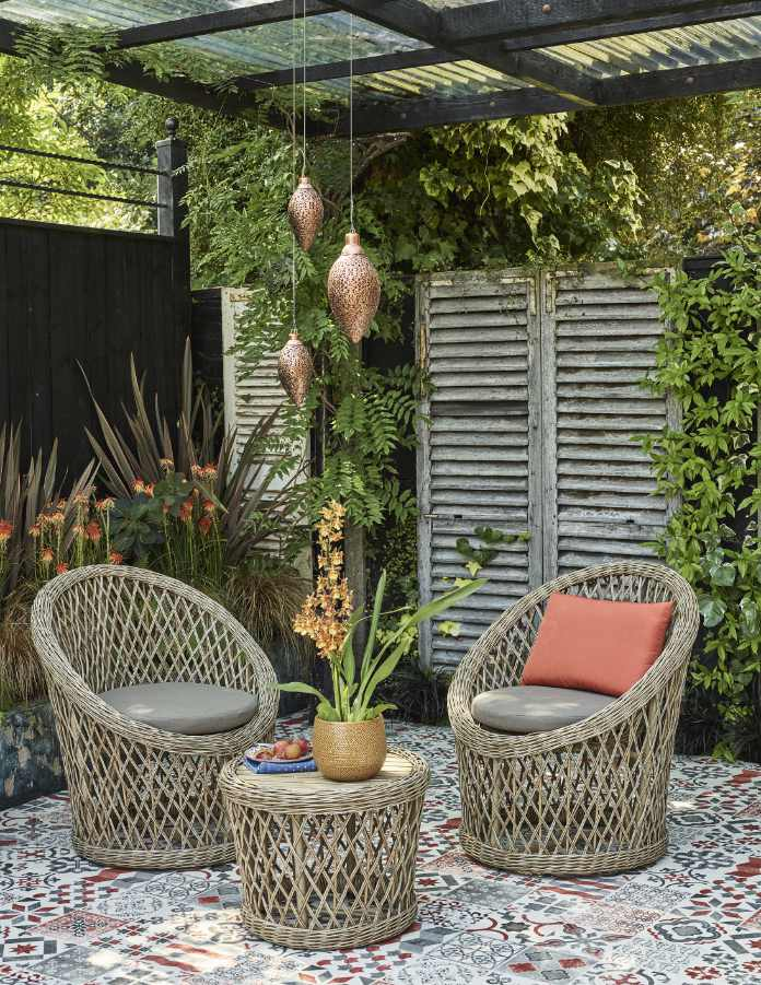 Stylish furniture and indoor plants can be brought outside (Dobbies Garden Centres/PA)