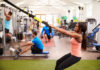 Hygiene tips for the gym – People working out on fitness equipment at a busy gym